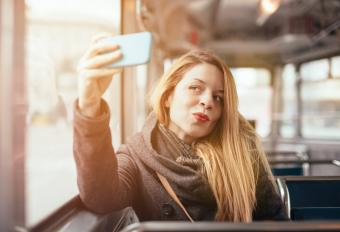 Girl posing with phone