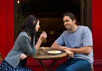Couple at sidewalk cafe