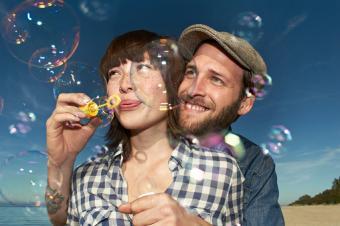 Couple blowing bubbles