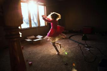 Little girl dancing in living room