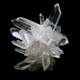 Quartz crystal cluster on black background