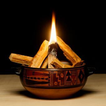 Bowl containing burning palo santo chips