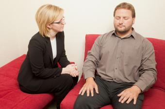 Hypnotist working with a male patient