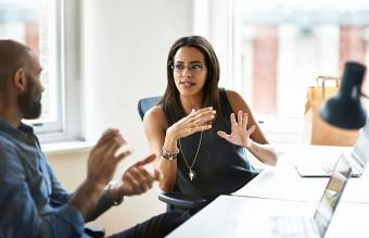 Woman and man talking in modern office