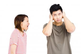 Woman yelling at frustrated man