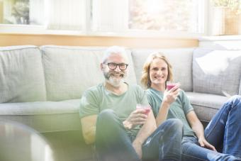 Older couple on floor with drinks