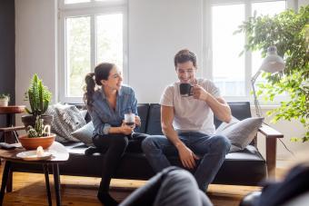 laughing couple having coffee
