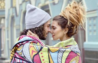 Couple wrapped in a blanket