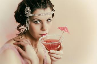 20s woman drinking a cosmo
