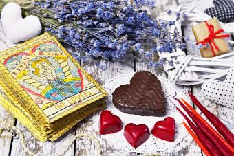 Tarot card Lovers, chocolate candies, heart and love symbols