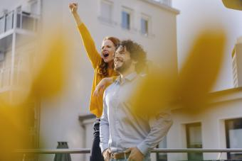 Excited couple on roof terrace