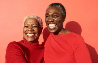 two women in red