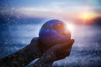 Small Hands holding the world with global connection