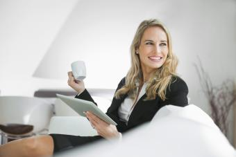 Businesswoman relaxing with digital tablet and a coffee