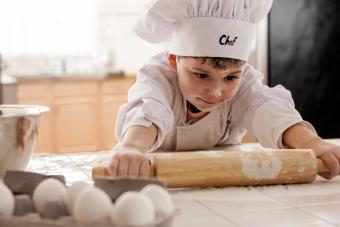 Boy rolling out dough