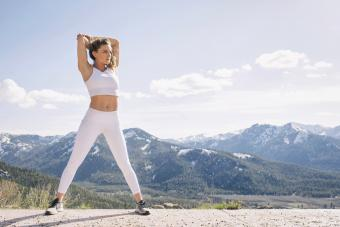 Young woman working out in mountain setting
