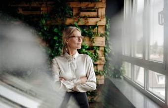 Businesswoman in green office