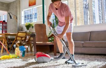 man doing housework vacuuming