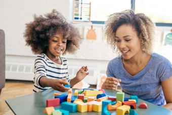 Child playing with blocks and talking