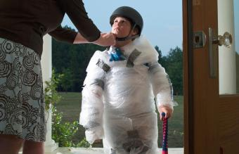 Child wrapped in bubble wrap