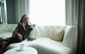 woman reclining on white luxury sofa