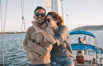 Couple enjoying view on sailboat