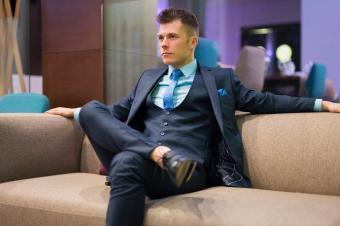 Stylish man sitting on sofa