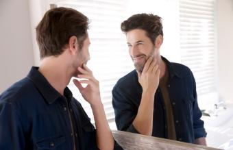 Man watching himself at mirror