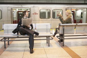 Man and woman flirting on subway platform