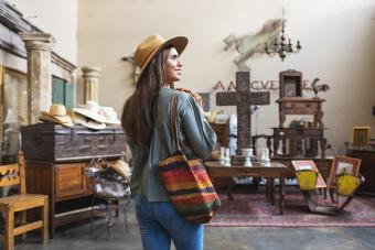 Young woman shopping in antique store