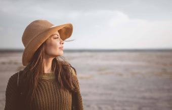 female explorer looking away in desert