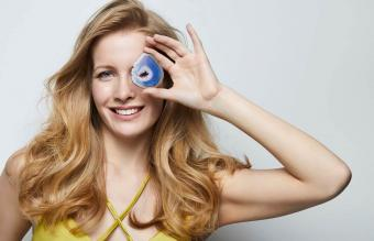 woman holding a blue agate gemstone