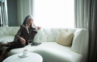 woman reclining on luxury sofa