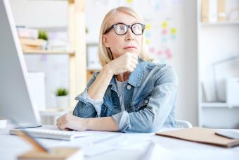 Serious pensive woman working