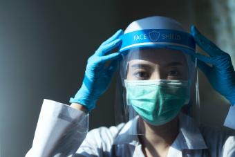Doctor wearing face shield and PPE suit