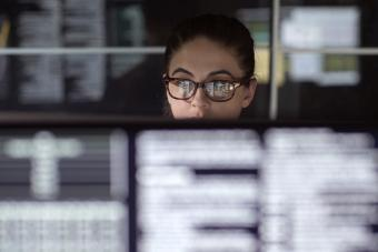 Data woman surrounded by monitors