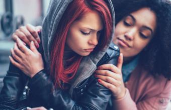 girl caring for depressed friend
