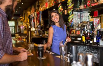 Barmaid serving male