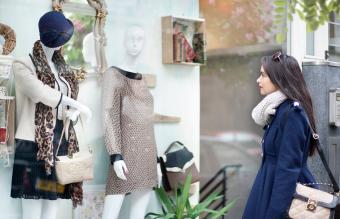 Lady looking at mannequin
