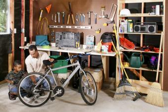 Father and son working on bike together in garage