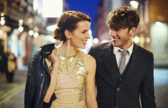 Couple on street at night