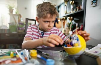 little boy making school project