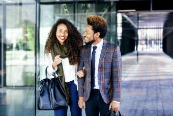 Well-dressed couple smiling