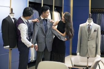 Young couple shopping in a men's wear store