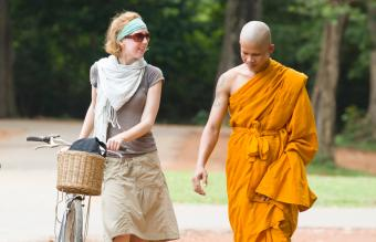 Tourist walking with local monk
