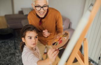 woman and granddaughter painting