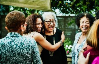 daughter embracing senior mother