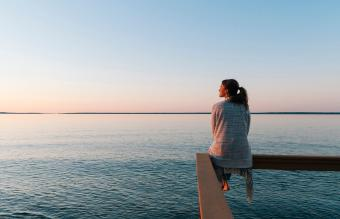 woman sitting on edge