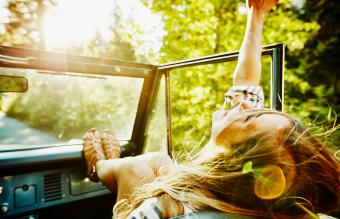 Woman riding in convertible