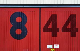Numbers on red metallic door